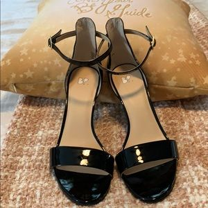 Black patent leather high-heeled sandals